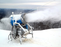 Snow making cannon machine. On top of a mountain in a winter sky resort stock images