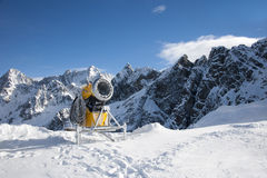 Snow Making Machine. A Snow Making Machine in the mountains Stock Images