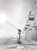 Snow making machine near chair-lift -  black and white. Snow making machine near chair-lift Stock Photos