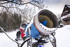 Snow making machine on piste at ski resort in snowy country. Snow making machine, cannon, blower, at ski resort royalty free stock photo