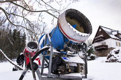 Snow making machine on piste at ski resort in snowy country. Snow making machine, cannon, blower, at ski resort stock images
