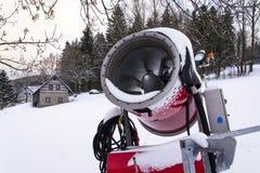 Snow making machine on piste at ski resort in snowy country. Snow making machine, cannon, blower, at ski resort stock photo