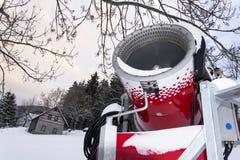 Snow making machine on piste at ski resort in snowy country. Snow making machine, cannon, blower, at ski resort stock image