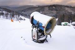 Snow making machine on piste at ski resort in snowy country. Snow making machine, cannon, blower, at ski resort stock photos