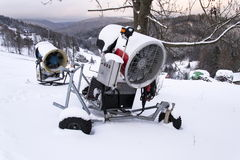 Snow making machine on piste at ski resort in snowy country. Snow making machine, cannon, blower, at ski resort royalty free stock photography