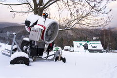 Snow making machine on piste at ski resort in snowy country. Snow making machine, cannon, blower, at ski resort stock photography