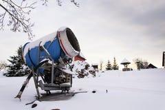 Snow making machine at ski resort in snowy country. Snow making machine, cannon, blower, at ski resort royalty free stock photos