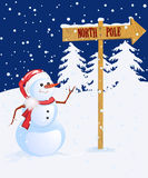 Snow man. Pointing to North Pole Royalty Free Stock Image