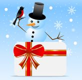 Snow man with a bird bullfinch and greeting-card Stock Photo