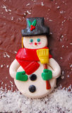 Snow man,on chocolate. Figurine,snow man,on a chocolate cake Stock Photos