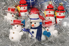 Snow man and Chrismas balls. On silver background Royalty Free Stock Photography