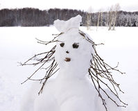 Snow man, fairy winter woman made of snow balls. Royalty Free Stock Photos