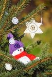 Snow man figurine in the christmas tree Royalty Free Stock Photos
