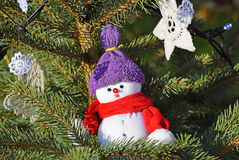 Snow man figurine in the christmas tree Royalty Free Stock Photography