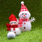 Snow man with golf ball