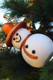 Snow man hanging on the Christmas tree. Stock Photography