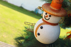 Snow man hanging on the Christmas tree. Stock Images