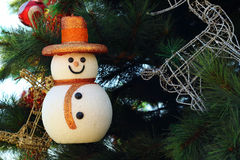 Snow man hanging on the Christmas tree. Royalty Free Stock Photo