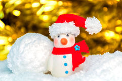 Snow man over blurred shiny yellow strip, and white background Stock Photography