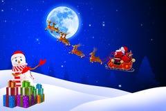 Snow man pointing towards santa and his sleigh Royalty Free Stock Photos