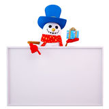 Snow man pointing towards sign with small gift Stock Photography