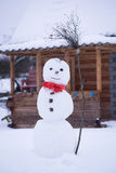 Snow man in red scarf, winter, december, january Royalty Free Stock Photos