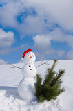 Snow man in santa cap Royalty Free Stock Photo