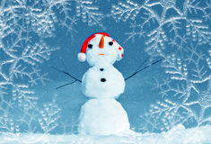 Snow man in santa cap on nature Royalty Free Stock Photos