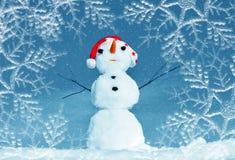 Snow man in santa cap on nature Royalty Free Stock Photos