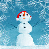 Snow man in santa cap on nature. In sunny cold day Royalty Free Stock Images