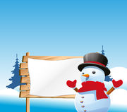 Snow Man And The Sign Board Royalty Free Stock Image