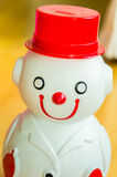 Snow man smiling and wearing suit piggy bank front view Stock Image