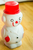 Snow man smiling and wearing suit piggy bank side view. Show tool of saving which friendly with children Royalty Free Stock Photo