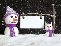 Snow man and snow cat with sign Royalty Free Stock Photography