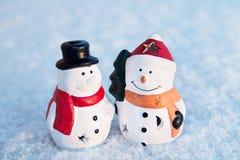 Snow man, snowman toy on snow background. Cristmas Royalty Free Stock Photo