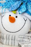 Snow man toy with glamour scarf. Snow man. Background for the Christmas & New Year's card Stock Photo