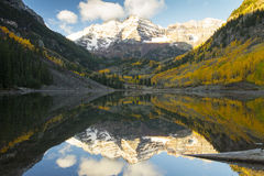 Snow on the Maroon Bells near Aspen Colorado. Snow on the Maroon Bells reflected in Maroon Lake near Aspen Colorado Stock Images
