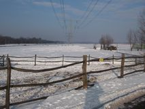 Snow on the meadows in the winter in Nieuwerkerk aan den IJssel in the Netherlands.  royalty free stock photography