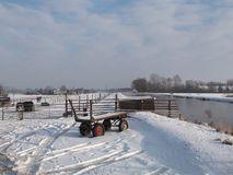 Snow on the meadows in the winter in Nieuwerkerk aan den IJssel in the Netherlands.  royalty free stock photos