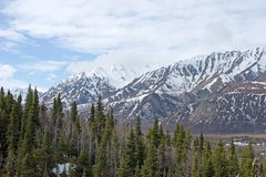 Snow melting on Alaska Range Stock Photo
