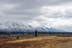 Snow melting on Alaska Range. Snow melting on mountains in Alaska Range Royalty Free Stock Images