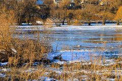 Snow melting on meadow Stock Image
