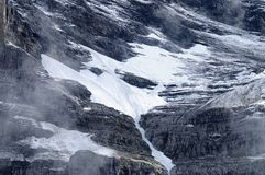 Snow melting on the mountain Stock Images