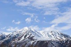 Snow melting on mountains stock photos