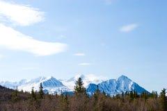 Snow melting on mountains royalty free stock photo