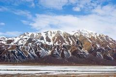 Snow melting on mountains stock photo