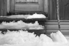 Snow Melting Near Door Stock Photo