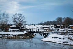 Small old wooden bridge on frozen lake stock photos