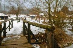 Small old wooden bridge on frozen lake royalty free stock photos