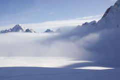 Snow and mist. On a remote glacier of Greenland Royalty Free Stock Photo